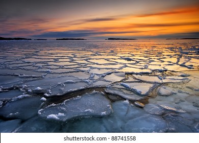 Early morning winter landscape with sunrise and ice floats, in the sea coast of Helsinki, Finland