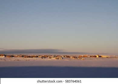 Early morning winter sunrise over Cambridge Bay, Nunavut with the new Canadian High Arctic Research Station on the right