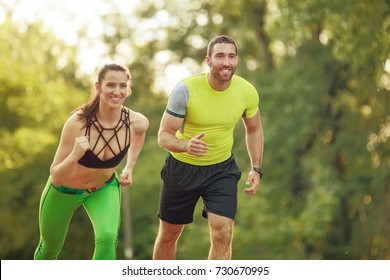 Early morning workout. Happy couple running. Living healthy lifestyle.