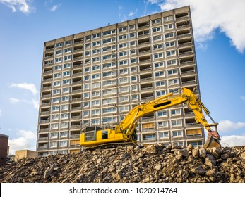 Early phase of urban housing construction site showing demolition of old council flats in London
