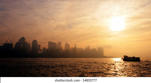 Early rising sun against new york skyline