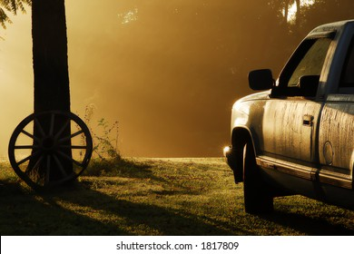 Early September morning in rural Tennessee.  Very foggy with sun-rays striking the pickup truck that is covered with heavy dew.  A very calm serene scene.