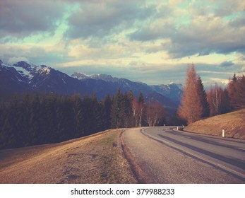 Early spring landscape in the mountains, on a sunny afternoon. Image filtered in faded, washed out, retro style with extremely soft focus; nostalgic vintage concept of early spring in nature.