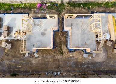 Early stages of construction, houses being build on the same lot alongside each other. Slab in and framework has been erected. Melbourne, Australia.