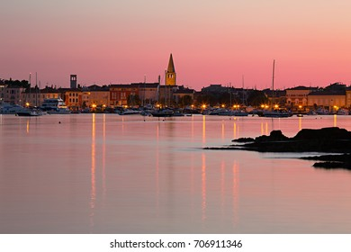Early summer morning in marina, view to old town of Porec in Croatia