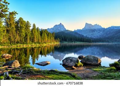 Early summer morning on mountain lake. Nature Park Ergaki. Western Sayan. Russia