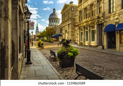 early summer morning sunny old Montreal cobblestone street historic buildings Quebec Canada