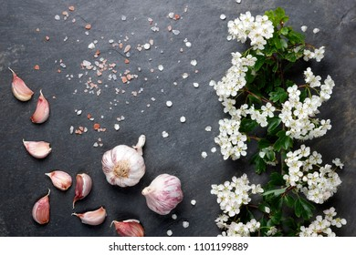 Early summer white  flower blossoms with pink garlic and Himalayan rock salt