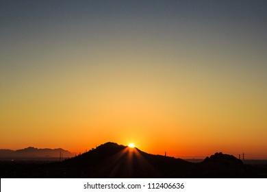 Early sun rises over the Arizona desert.