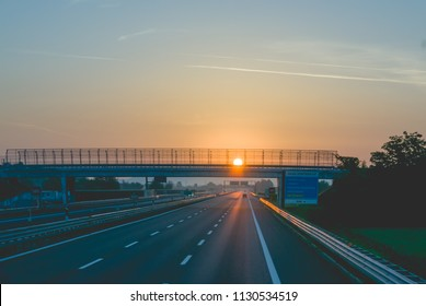 Early sunrise over motorway in Europe
