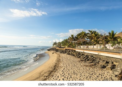 Early sunset over the beach in Saint Gilles les Bains, a famous resort town in the Reunion island, which belong to France in the Indian Ocean