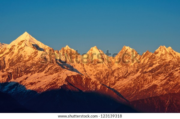 early sunset over Panchachuli Peaks in Indian Himalayas