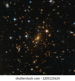 Early Universe. Hubble image. Cluster of galaxies, dark matter, dark energy. Elements of this image furnished by NASA.