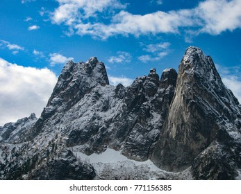 Early Winters Spires, Concord Tower, Lexington Tower and Liberty Bell Mountain in North Cascades National Park, Washington in a late autumn view as winter snow accumulates