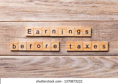 Earnings Before Interest Taxes word written on wood block. abbreviation EBIT text on wooden table for your desing, concept.