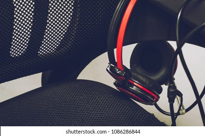 Earphone Black red and Black chair White background