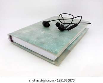 Earphone and book vintage background