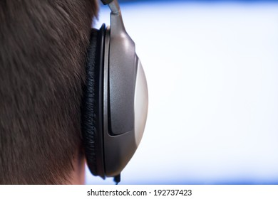 Earphone closeup on glowing background monitor