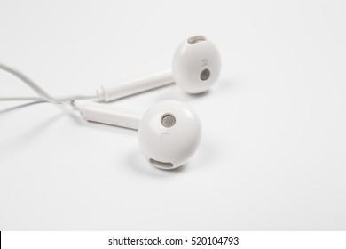 Earphone or earphones on white background.the white earphones for using digital music or smart phone.