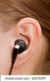 Ear-phone in a female ear