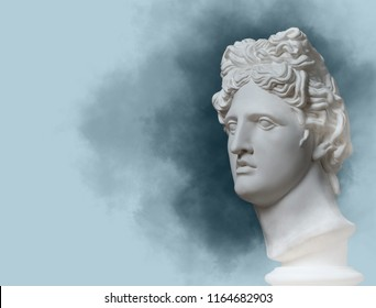 Earphone. Isolated.  Gypsum statue of Apollo's head. Man. Statue. Blue statue of Apollo's head. Head.