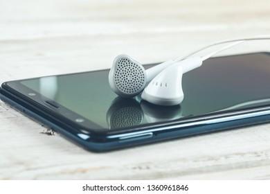 earphone on phone on desk