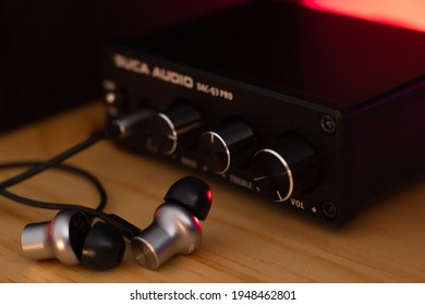 Earphones on a table connected to a DAC
