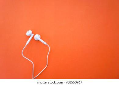Earphones for Smartphone on Orange Background