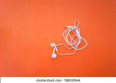 Earphones for Smartphone with Tangle Cable Line on Orange Background