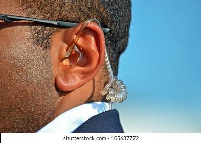earpiece in a Secret Service agent's ear