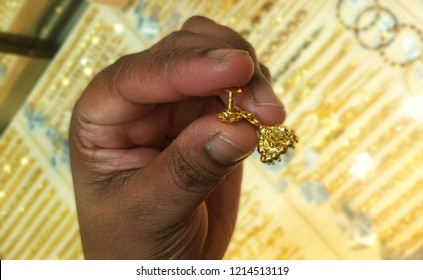 Earring on hand.This photo taken form one of the Jewalary.4 gram Gold,24 carate gold