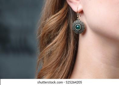 Earring on woman's ear.