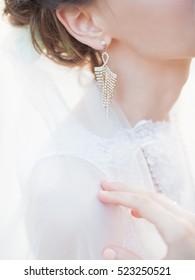 earring in woman's ear