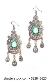 earrings with emeralds isolated on white