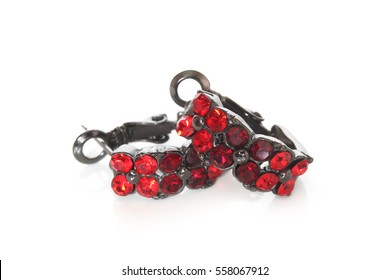 Earrings with garnet on white background