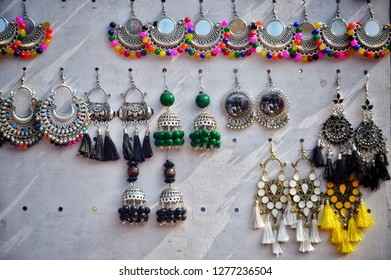 "Earrings are much interesting things to be photographed. Here, this is a collection of earrings (locally called ""jhumko"" or ""jhumka"") on a white canvas. It was captured in Shantiniketan Poushmela 2018"