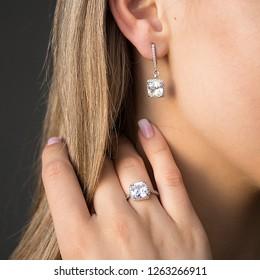 earrings on the ears and finger rings, women's jewelry, jewelry