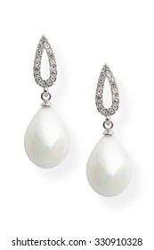 Earrings with pearls and diamonds isolated on white