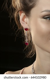 earrings with red gems