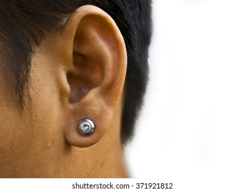 Ears with earrings on white background