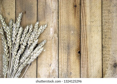 Ears of wheat on a wooden table