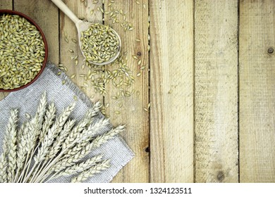 Ears of wheat and rye on a wooden table