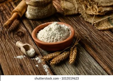 ears of wheat and white flour - closeup