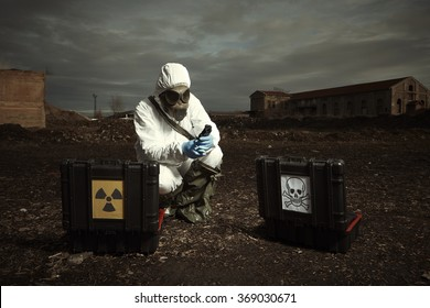 Earth after nuclear war - soldier checking samples of soil
