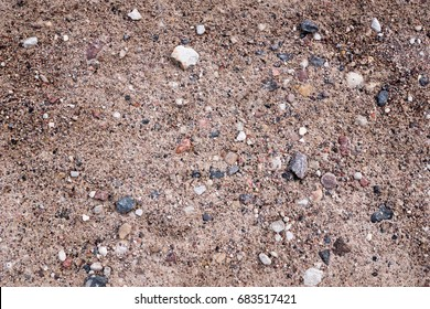 Earth background with stones. Road sand and stones.