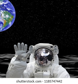 Earth behind the astronaut. Astronaut on the moon. The elements of this image furnished by NASA.