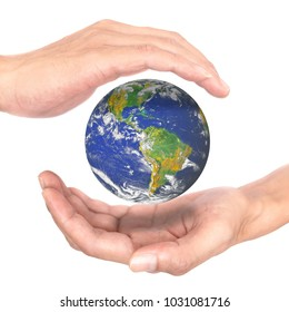 Earth between hands representing environment conservation and save earth concept. Elements of this image furnished by NASA.