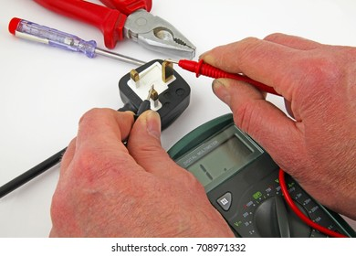 Earth continuity testing – An electrician testing for a earth fault  betweenthe live cable and earth with a multimeter