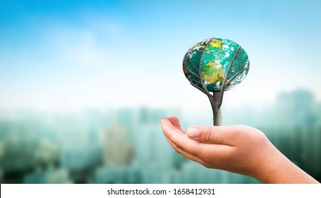 Earth day concept: Human hands holding earth global over  nature background