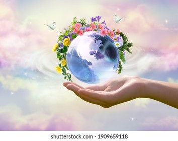 Earth Day or World Environment Day concept. Save our Planet, restore and protect green nature, sustainable lifestyle and Climate literacy theme. Blooming rose, daisy flowers on globe in hand, 22 april